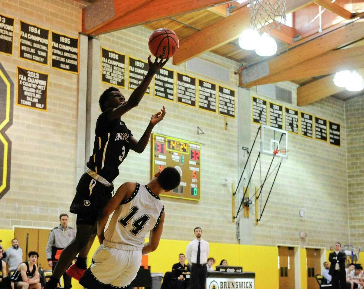 Hamden Hall plays Brunswick in a FAA boys basketball game last year at Brunswick School in Greenwich.