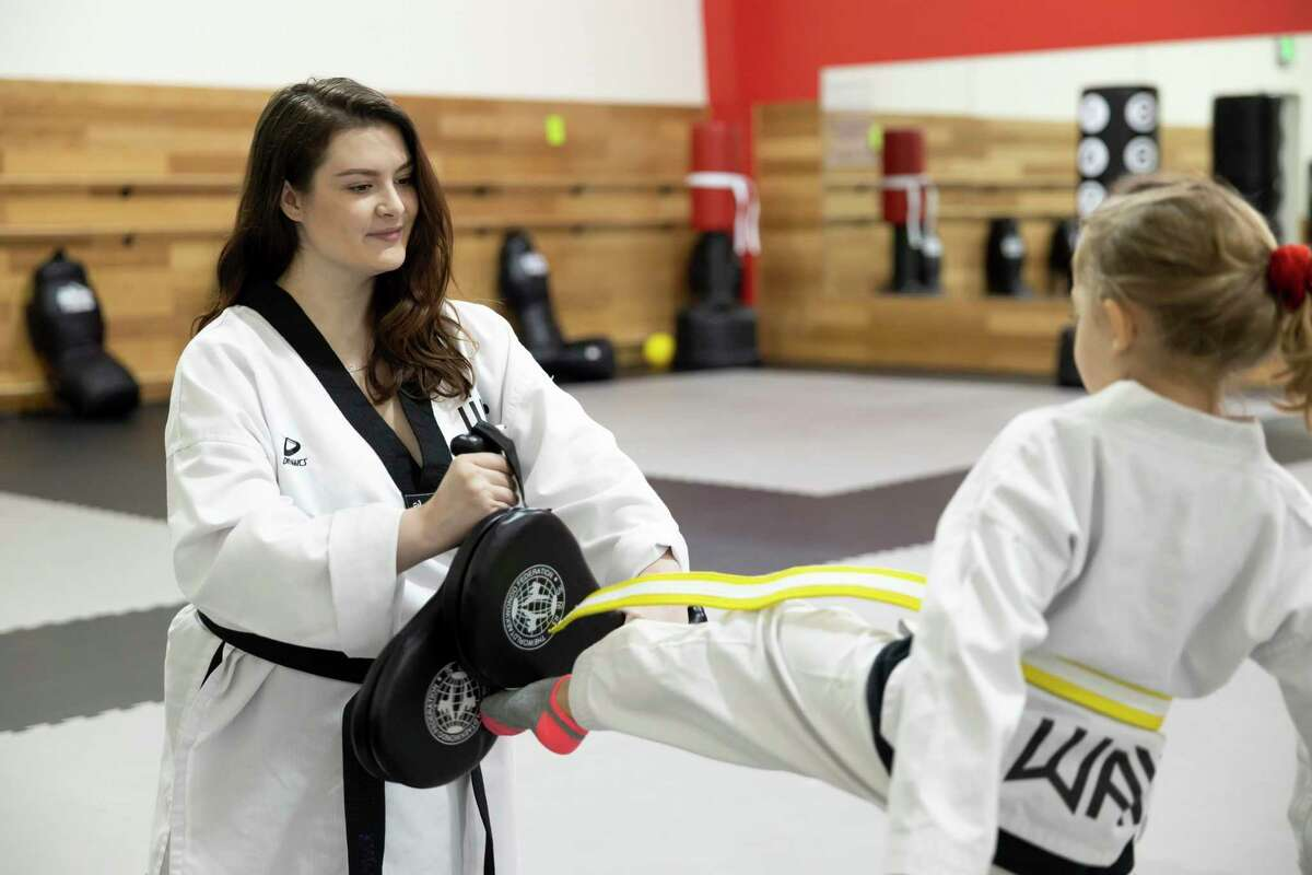 Head coach Becka Butler leads a taekwondo lesson at The Way Family Dojo, Wednesday, Jan. 20, 2021, in Magnolia. The dojo offers free self defense courses to women every Saturday.