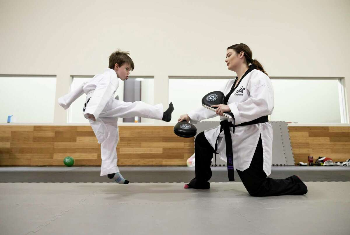 Loxley Palacios, left, practices taekwondo with head coach Becka Butler at The Way Family Dojo, Wednesday, Jan. 20, 2021, in Magnolia. The dojo offers free self defense courses to women every Saturday.