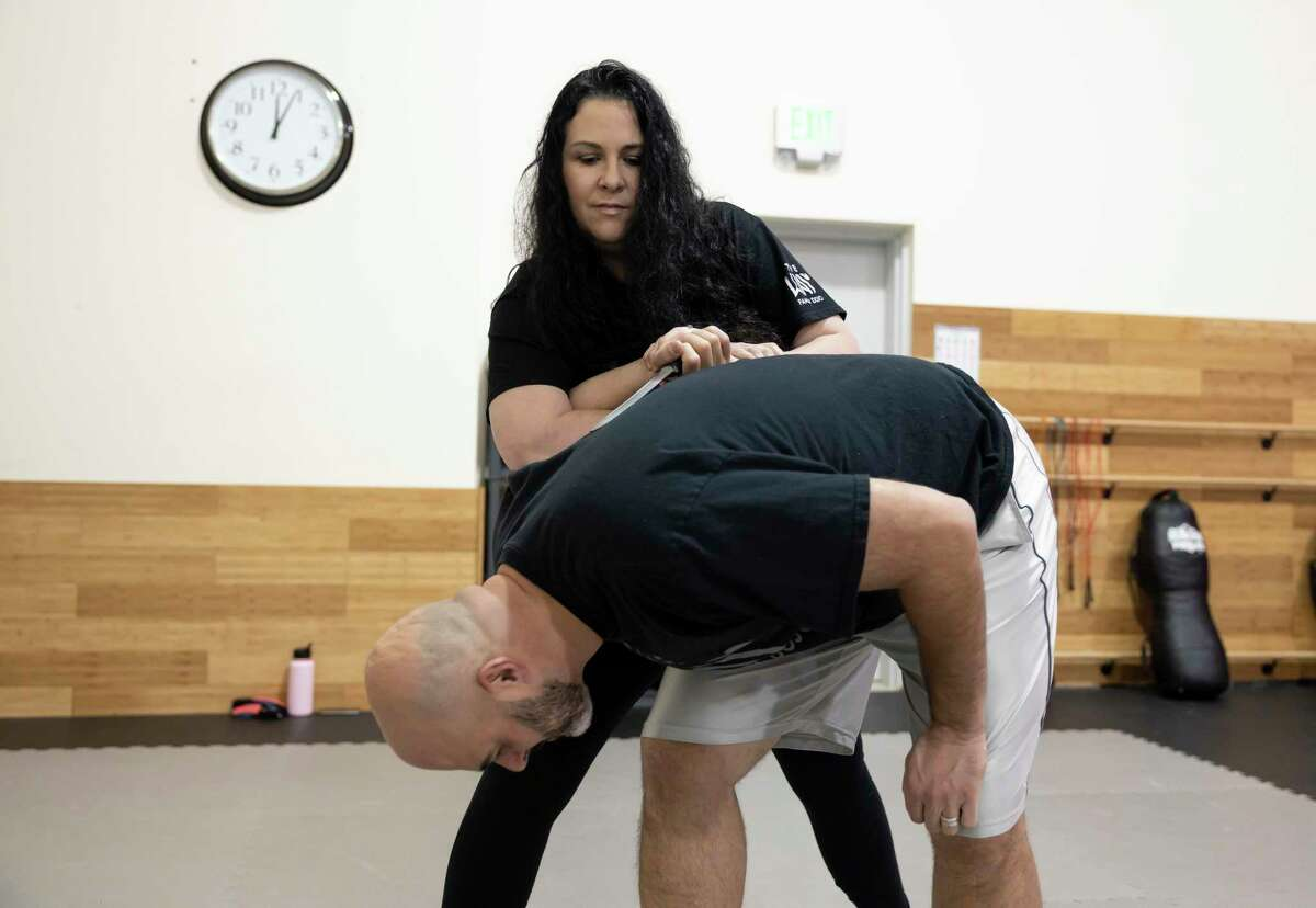 Master Tisha Butler, standing, practices self defense techniques with Keith Noack at The Way Family Dojo, Wednesday, Jan. 20, 2021, in Magnolia. Noack has been a part of the self defense courses since October of 2020.