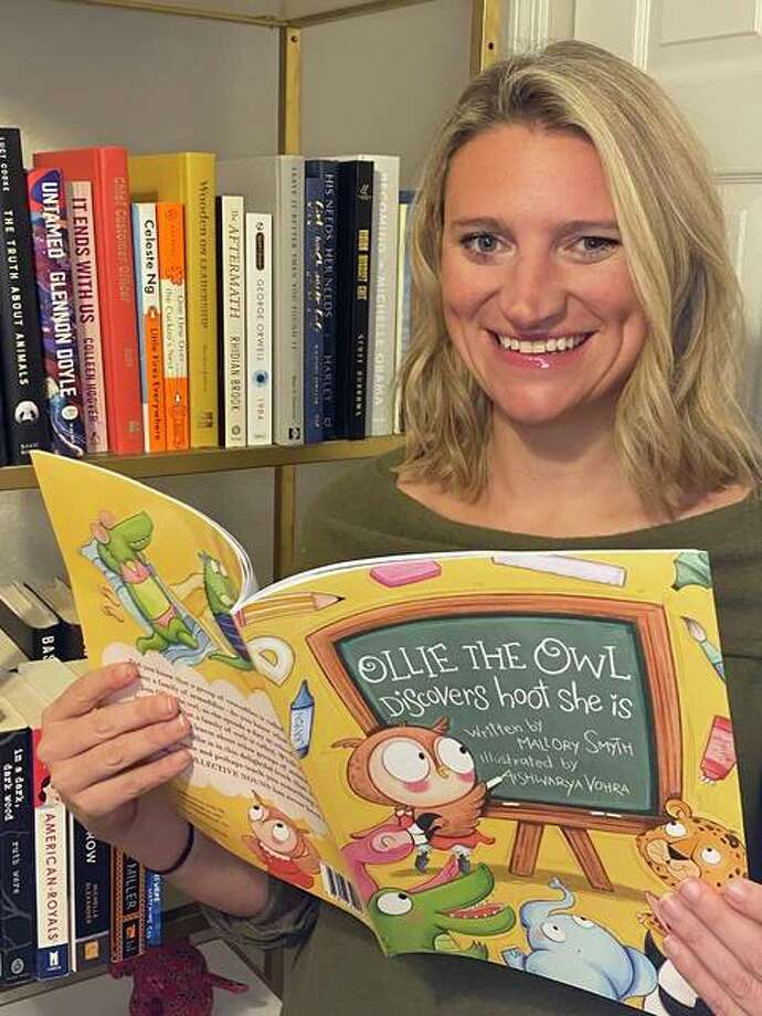 """Mallory Smyth with her new children's book, """"Ollie The Owl: Discovers hoot she is."""" The proceeds from book sales aid three groups, including Edwardsville CEO. Photo: Courtesy Of Mallory Smyth