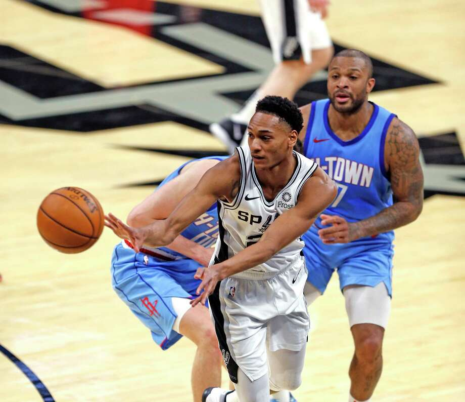 Devin Vassell #24 of the San Antonio Spurs saves the ball from going out of bounds. Rockets v Spurs at AT&T Center on Saturday, Jan. 16, 2021 Photo: Ronald Cortes /Contributor / 2021 Ronald Cortes