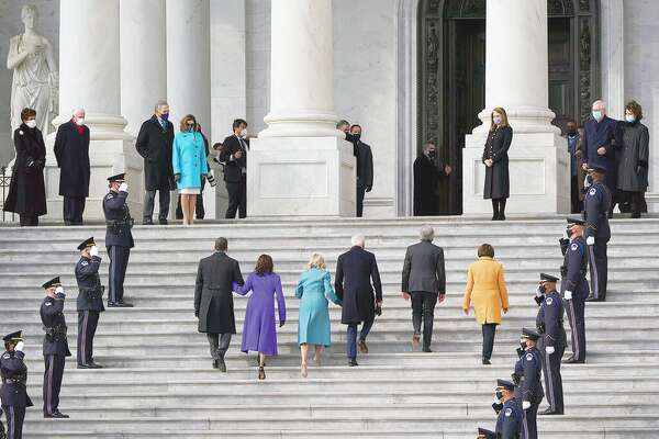 Joe Biden, his wife, Jill, and Kamala Harris and her husband, Doug Emhoff, arrive at the steps of the U.S. Capitol for the start of the official inauguration ceremonies Wednesday.