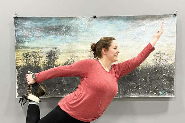 Certified yoga instructor Heather Garrigus strikes a dancer pose at her new 1,500-square-foot studio, Heather's Zen Den Yoga Studio, at 95 Eastgate Plaza Shopping Center, in East Alton. Garrigus, of Godfrey, will open Saturday, Feb. 6, with an open house from 9 a.m. to 5 p.m. The opening is open to the public and free to attend.