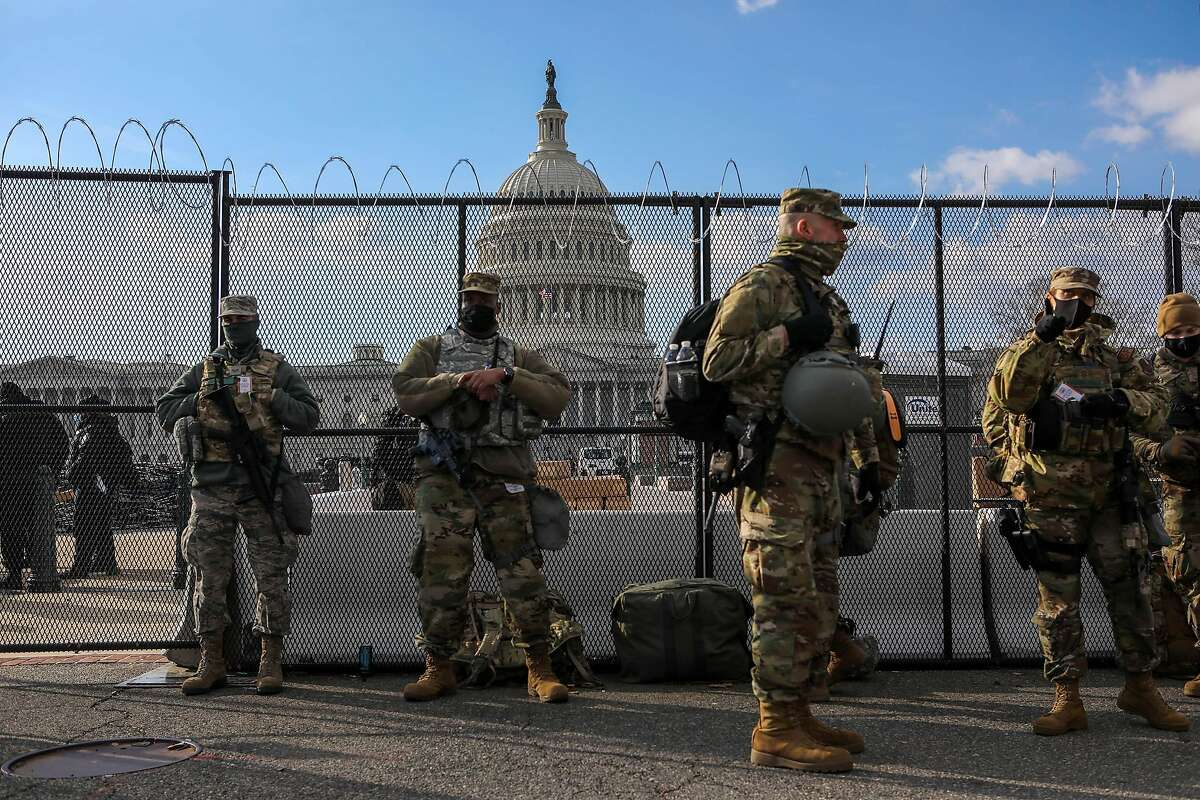 Members of the National Guard stand in front of the Capitol Building during Inauguration Day on Wednesday, January 20, 2021, in Washington, D.C.