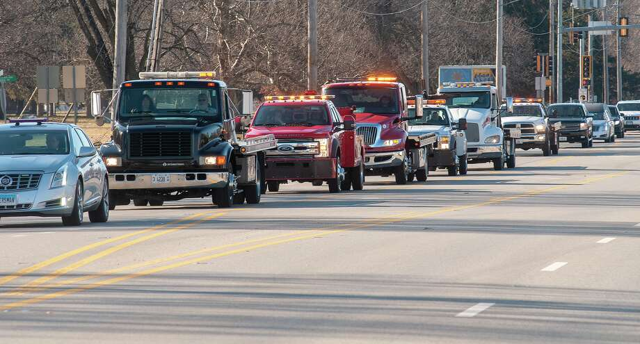 Jacksonville- and Beardstown-based tow trucking companies lead a funeral procession Wednesday for Steve McNeece. McNeece, who died Jan. 14, was the owner and operator of Steve's Fuel and Auto Care at Main Street and Morton Avenue. Photo: Darren Iozia | Journal-Courier / Jacksonville Journal-Courier