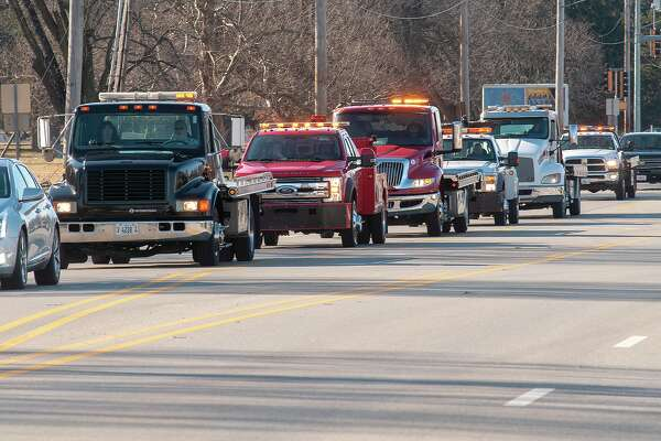 Jacksonville- and Beardstown-based tow trucking companies lead a funeral procession Wednesday for Steve McNeece. McNeece, who died Jan. 14, was the owner and operator of Steve's Fuel and Auto Care at Main Street and Morton Avenue.