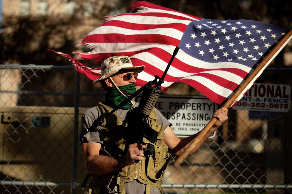 A supporter of Donald Trump protests outside the Arizona Capitol in Phoenix on Wednesday, Jan. 20, 2021.