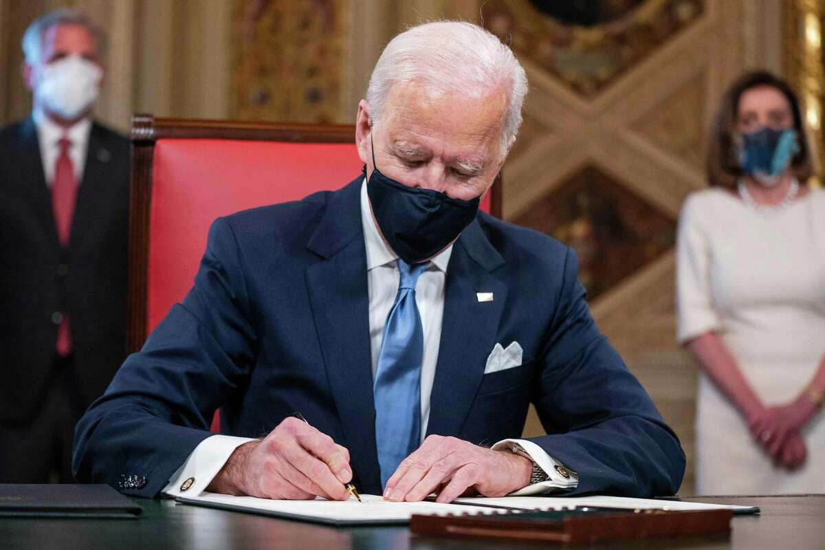 US President Joe Biden signs three documents including an Inauguration declaration, cabinet nominations and sub-cabinet noinations. Biden also issued executive orders to reverse policies on climate change and immigration put in place by former President Donald Trump.