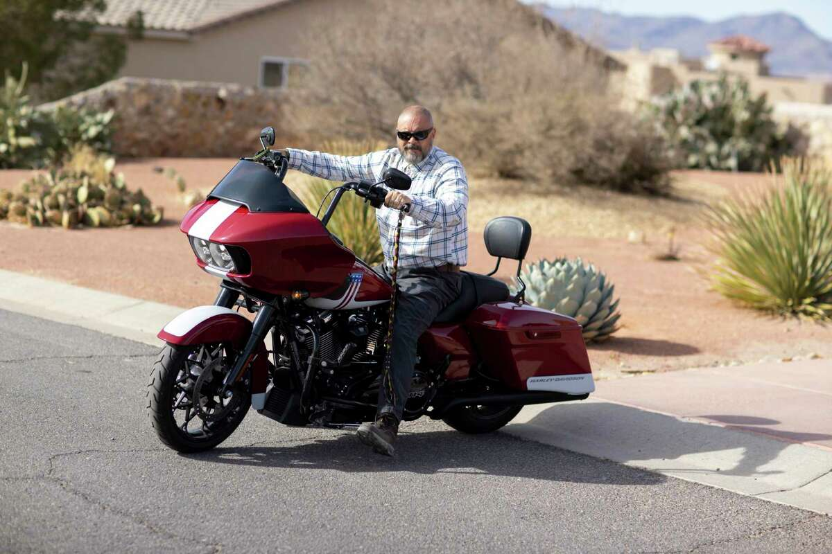 U.S. Army Command Sgt. Maj. (Retired) William Willie Apodaca-Fisk rides one of his three motorcycles outside his home, Thursday, January 14, 2021, in Las Cruces, N.M.
