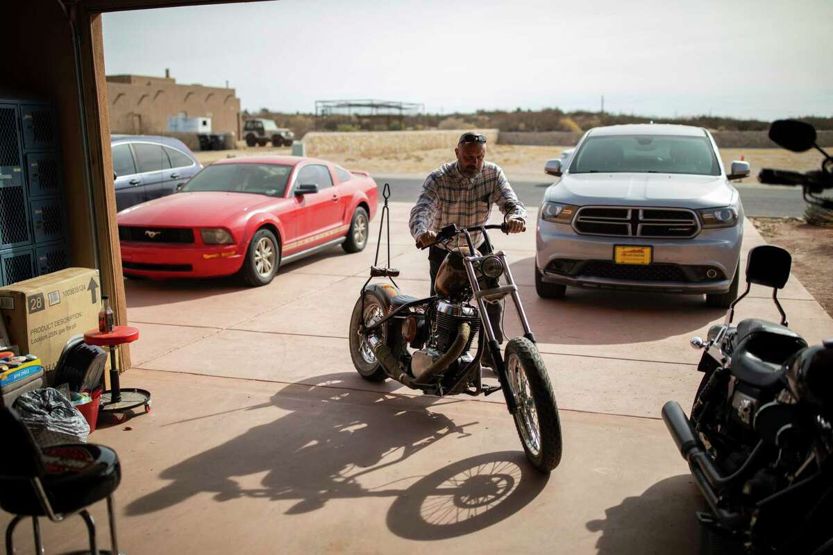 U.S. Army Command Sgt. Maj. (Retired) William Willie Apodaca-Fisk sits on one of his three motorcycles outside his home, Thursday, January 14, 2021, in Las Cruces, N.M.