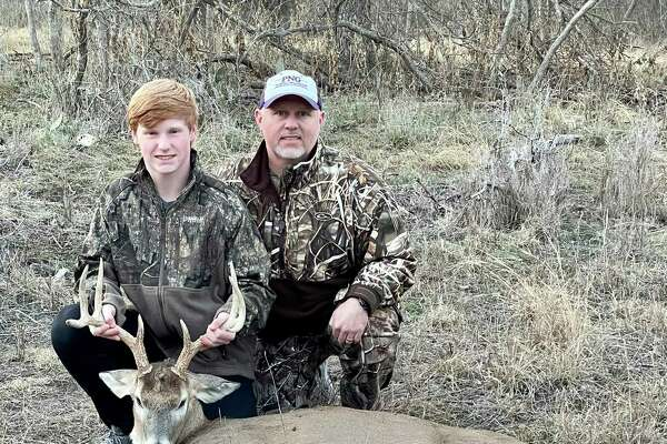 Brandon Faircloth (right) and Cooper Faircloth (left) with their kill on Monday, Dec. 23, 2020 in Goldthwaite, TX.
