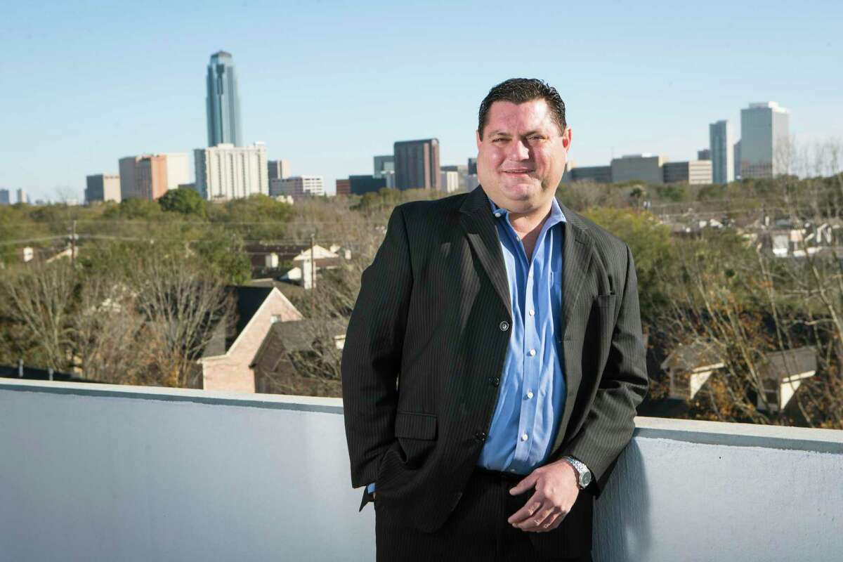 Jonathan Click, of Click Energy, LLC, poses for a portrait Wednesday, Jan. 13, 2021 in Houston. Click is a Houston landman who has found work in the solar industry during the oil downturn