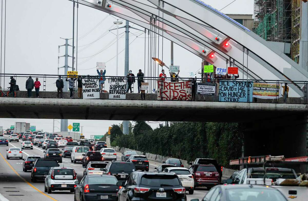 Members of the group Brown Berets dropped a banner from the Montrose Bridge over highway 59, in Houston. After meeting up in Emancipation Park, the group caravanned to the Montrose bridge asking for a National call to action on immigration.