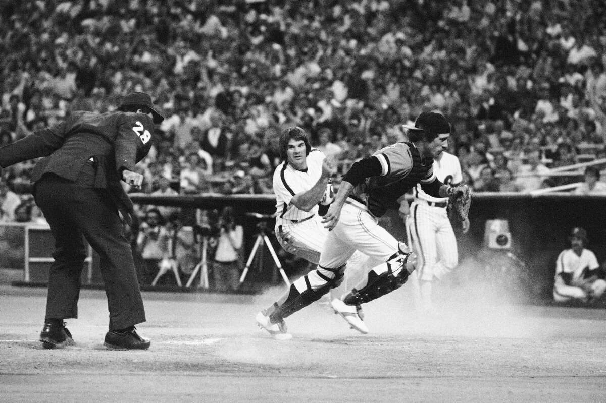 Phillies' Pete Rose turns as he crosses the plate to watches San Francisco Giants' catcher Mike Sadek chase down the ball that went by him in the first inning on Friday, July 7, 1979, game in Philadelphia. Rose scored on a single from second base as the Phillies won, 6-1.
