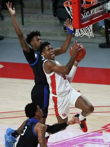 Houston Cougars guard Marcus Sasser (0) goes for a lay up during the first half of the AAC game against the Tulsa Golden Hurricane Wednesday, Jan. 20, 2021, at Fertitta Center in Houston. Photo: Yi-Chin Lee, Staff Photographer / © 2021 Houston Chronicle