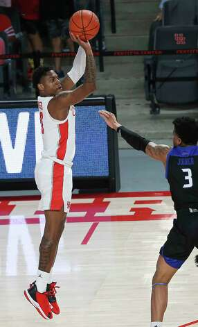 Houston Cougars guard Marcus Sasser (0) shoots a three point basket while Tulsa Golden Hurricane guard Elijah Joiner (3) is trying to stop him during the first half of the AAC game Wednesday, Jan. 20, 2021, at Fertitta Center in Houston. Photo: Yi-Chin Lee, Staff Photographer / © 2021 Houston Chronicle