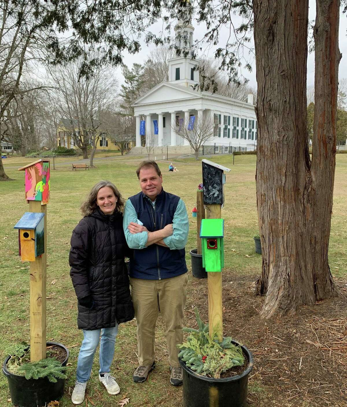 From left, Rev. Sarah Vetter, who along with her husband, the Rev. Todd Vetter, stand among the Heart Houses in front of the First Congregational Church in Madison.