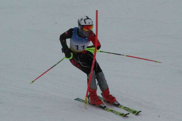 Ethan Novak cruises through a slalom gate during a race at Caberfae on Jan. 19. (Record Patriot file photo)