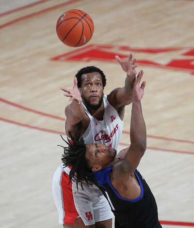 Tulsa Golden Hurricane guard Brandon Rachal (1) tries to steal a pass from Houston Cougars forward Justin Gorham (4) during the second half of the AAC game Wednesday, Jan. 20, 2021, at Fertitta Center in Houston. Photo: Yi-Chin Lee, Staff Photographer / © 2021 Houston Chronicle