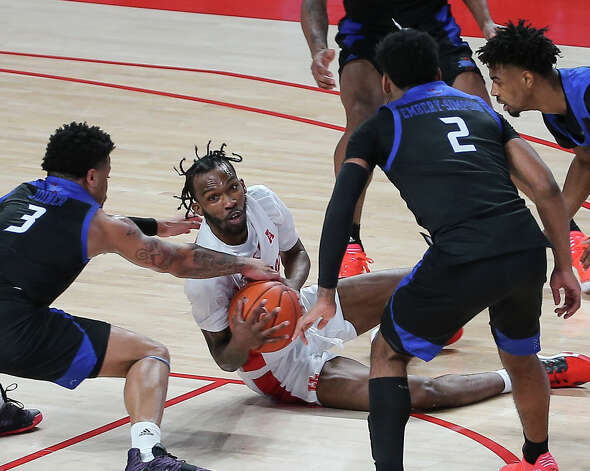 Houston Cougars guard DeJon Jarreau (3) looks for teammates to make a pass while surrounded by Tulsa Golden Hurricane players during the second half of the AAC game Wednesday, Jan. 20, 2021, at Fertitta Center in Houston. Photo: Yi-Chin Lee, Staff Photographer / © 2021 Houston Chronicle