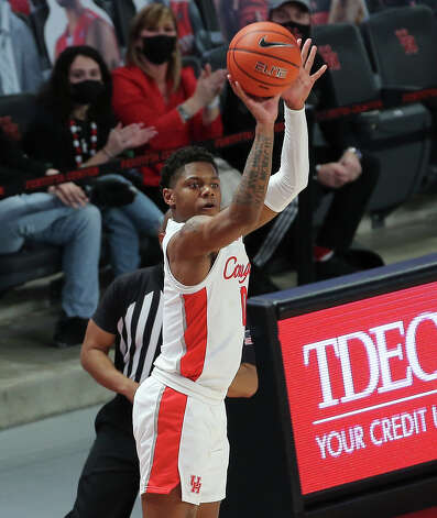 Houston Cougars guard Marcus Sasser (0) aimes for a three point basket during the second half of the AAC game against the Tulsa Golden Hurricane Wednesday, Jan. 20, 2021, at Fertitta Center in Houston. Photo: Yi-Chin Lee, Staff Photographer / © 2021 Houston Chronicle