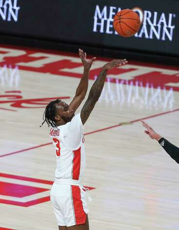 Houston Cougars guard DeJon Jarreau (3) aims for a three point basket during the first half of the AAC game against the Tulsa Golden Hurricane Wednesday, Jan. 20, 2021, at Fertitta Center in Houston. Photo: Yi-Chin Lee, Staff Photographer / © 2021 Houston Chronicle