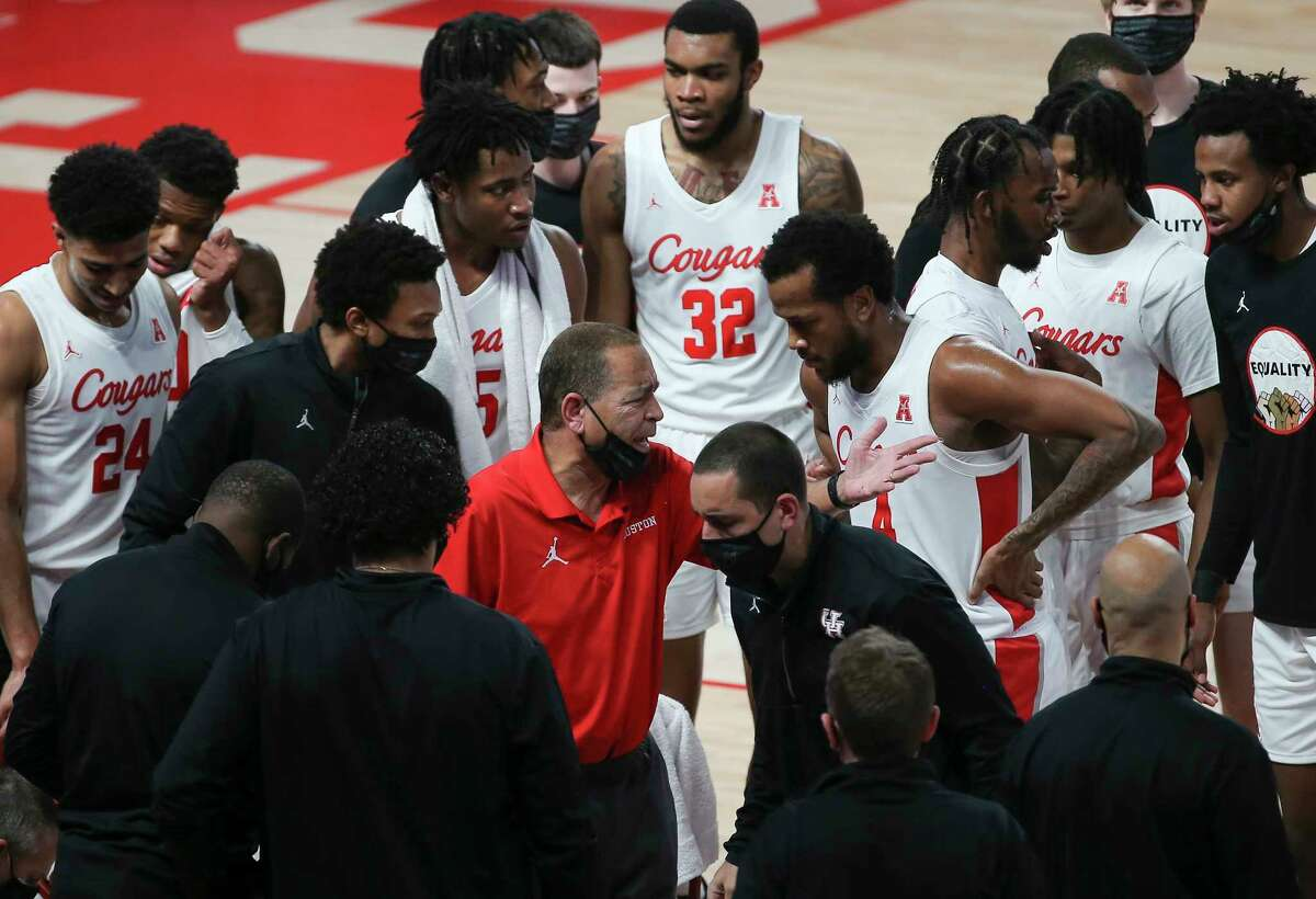 Houston Cougars head coach Kelvin Sampson talks to his players during a timeout in the first half of the AAC game against the Tulsa Golden Hurricane Wednesday, Jan. 20, 2021, at Fertitta Center in Houston.