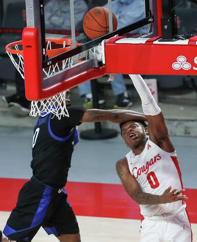 Houston Cougars guard Marcus Sasser (0) is fouled by Tulsa Golden Hurricane guard Curtis Haywood II (0) during the first half of the AAC game Wednesday, Jan. 20, 2021, at Fertitta Center in Houston. Photo: Yi-Chin Lee, Staff Photographer / © 2021 Houston Chronicle