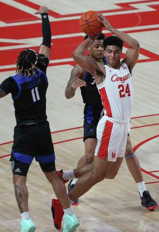 Houston Cougars guard Quentin Grimes (24) passes the ball during the first half of the AAC game against the Tulsa Golden Hurricane Wednesday, Jan. 20, 2021, at Fertitta Center in Houston. Photo: Yi-Chin Lee, Staff Photographer / © 2021 Houston Chronicle