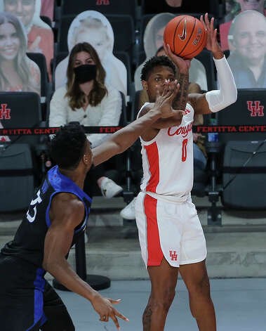 Houston Cougars guard Marcus Sasser (0) aims for the basketball while Tulsa Golden Hurricane forward Rey Idowu (25) is trying to stop him during the first half of the AAC game Wednesday, Jan. 20, 2021, at Fertitta Center in Houston. Photo: Yi-Chin Lee, Staff Photographer / © 2021 Houston Chronicle