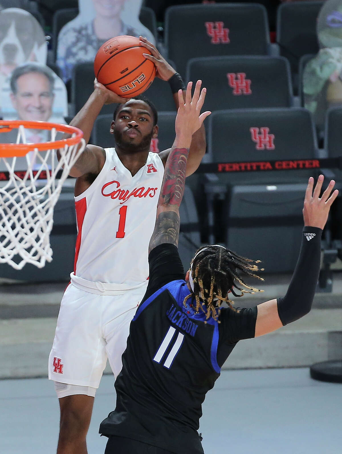 Houston Cougars guard Jamal Shead (1) aims for the basket while Tulsa Golden Hurricane guard Darien Jackson (11) is trying to stop him during the second half of the AAC game Wednesday, Jan. 20, 2021, at Fertitta Center in Houston. Houston Cougars defeated Tulsa Golden Hurricane 86-59.