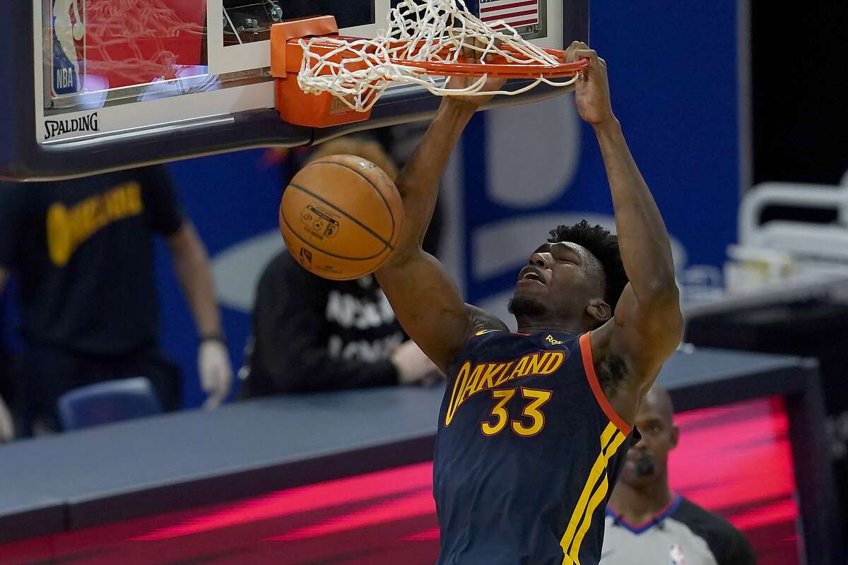 Golden State Warriors center James Wiseman (33) dunks against the San Antonio Spurs during the second half of an NBA basketball game in San Francisco, Wednesday, Jan. 20, 2021. (AP Photo/Jeff Chiu)