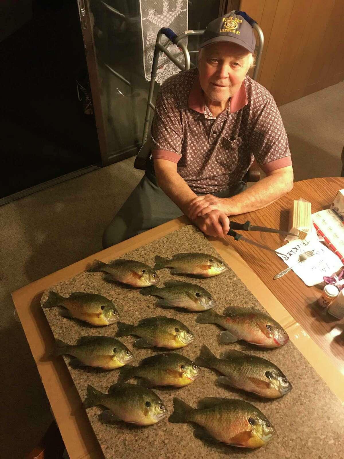 Baldwin's Jim Warren enjoys the rewards of his recent ice fishing venture. (Courtesy photo)