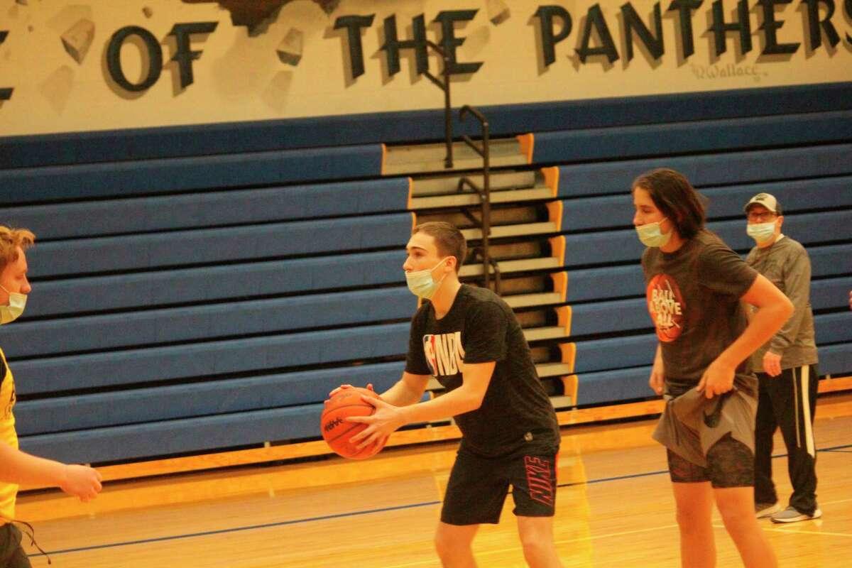 Baldwin senior Derek Mock works on his shooting during basketball practice on Saturday. (Star photo/John Raffel)