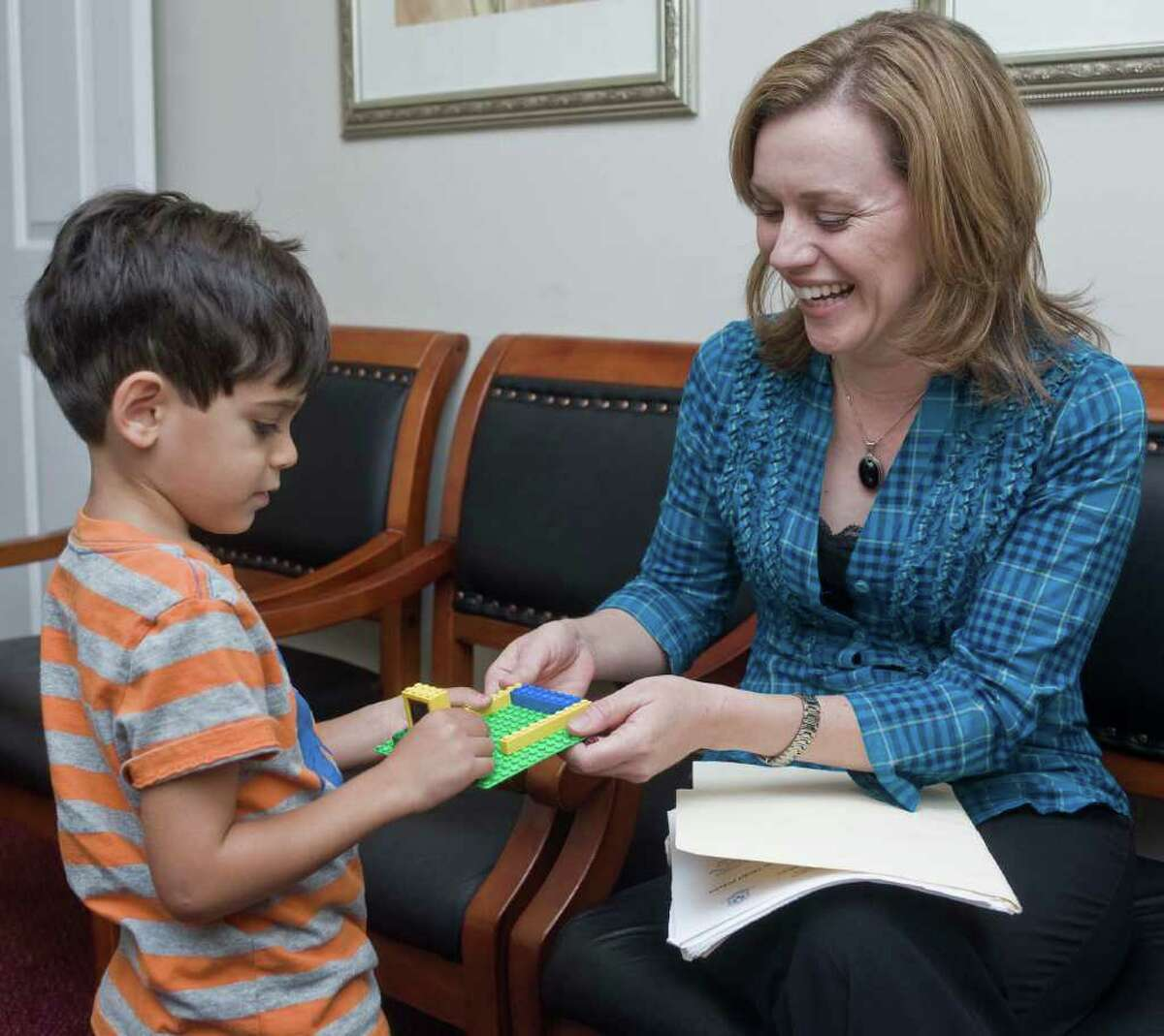 Eamonn Abdulrahman, 5, works with his mom Lauren Wolfe on a Legos activity in Ridgefield. Lauen is a nationally certified counselor who talks about the pressure society places on adolescent girls regarding their appearance. She encourages parents to give positive messages to their daughters to help counteract this pressure. Friday, Sept. 3, 2010