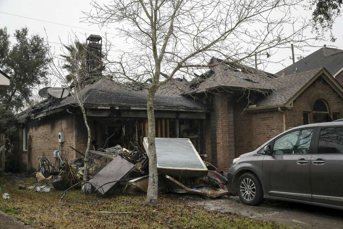 The scene of an overnight fire, photographed Thursday, Jan. 21, 2021, in the 21500 block of Wellsford Glen Dr. in Katy. It was reported that two people were critically injured in the fire.