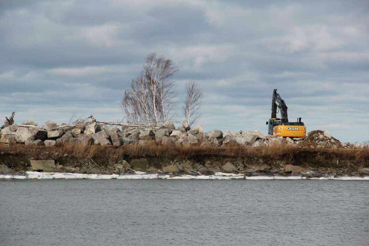 Some large rocks lined along the north point of Grindstone Harbor. The rocks will help prevent further erosion along the harbor. (Robert Creenan/Huron Daily Tribune)