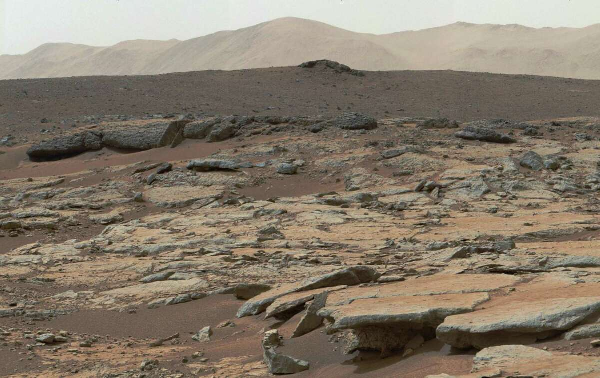 This mosaic of images from the Mast Camera (Mastcam) instrument on NASA's Curiosity Mars rover released Dec. 9, 2013 shows a series of sedimentary deposits in the Glenelg area of Gale Crater.