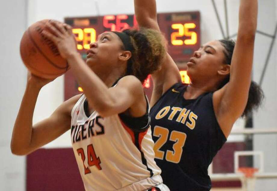 Edwardsville's Ariana Bennett goes up strong to the basket late in the second quarter against O'Fallon at Belleville West last season.