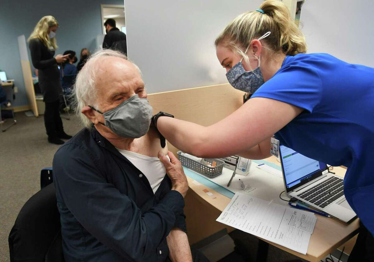 Senior Burton Fine, of Woodbridge, receives the first dose of his two part Covid-19 vaccine from nurse Molly Veale, RN, at the Griffin Health Vaccination Center at 10 Progress Drive in Shelton, Conn. on Wednesday, January 20, 2021.