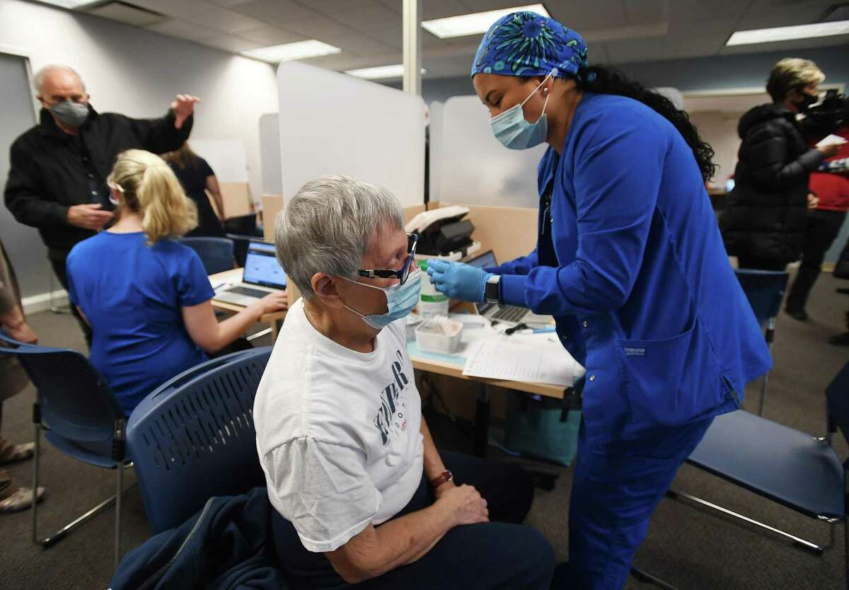 Senior Beverly Rosner, of Shelton, receives the first dose of the two part Covid-19 vaccine from nurse Raola Vigil, RN, at the Griffin Health Vaccination Center at 10 Progress Drive in Shelton, Conn. on Wednesday, January 20, 2021.