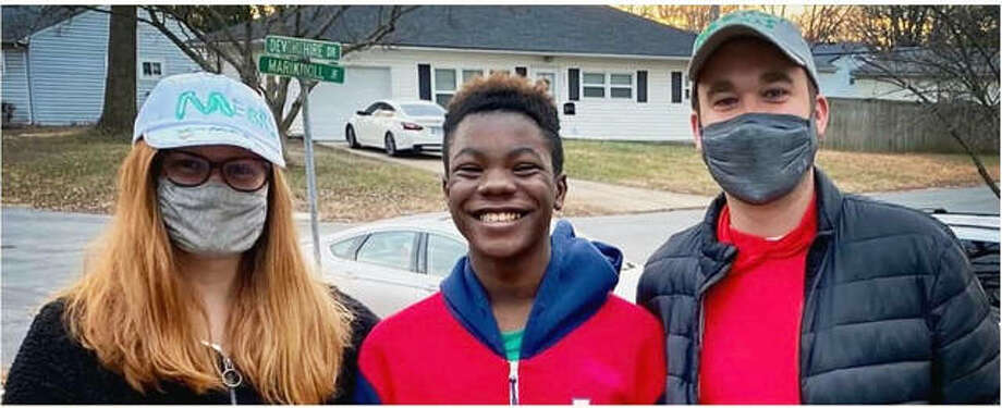 Levi, right, is a Big Brother to Shavarion, middle, through Big Brothers Little Sisters of Southwestern Illinois. Levi's wife is also pictured. Photo: For The Intelligencer