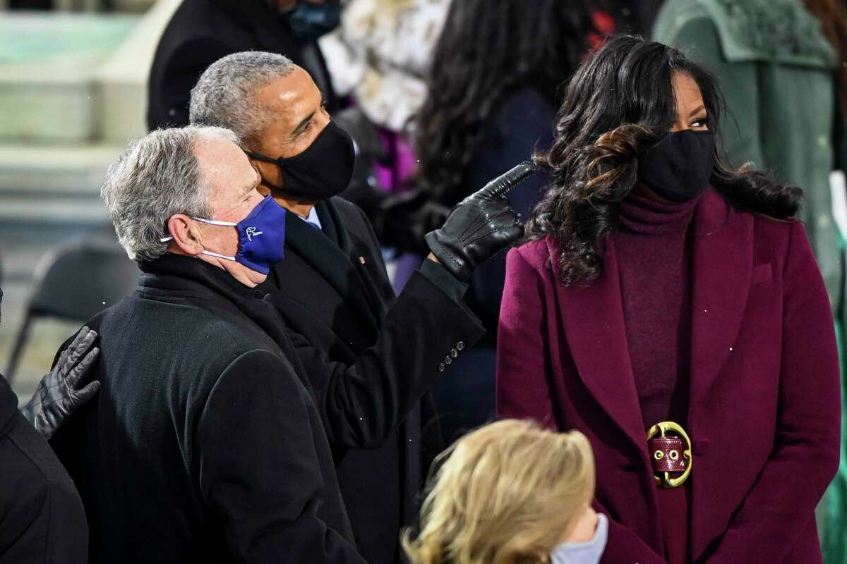 Former presidents George Bush and Barack Obama, along with former first lady Michelle Obama gather before Joe Biden was sworn in on Jan. 20 in Washington.