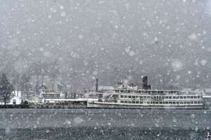 A light snow speckles the view across Lake George from Million Dollar Beach on Thursday, Jan. 21, 2021, in Lake George, N.Y.  (Will Waldron/Times Union)