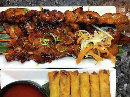 The menu at Sari-Sari Filipino Restaurant Market & Bakery includes grilled pork skewers and fried lumpia.