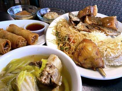 The lunch buffet at Susie's Lumpia House on Culebra Road includes, clockwise from front, beef-shank soup, fried lumpia, leche flan, rice pudding, lechom kawali, fried scrod, pancit and pork adobo.