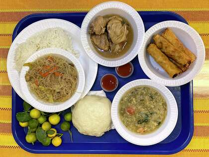 The cafe at Tabares Philippine Market in Universal City serves, clockwise from top left, pancit, pork adobo, lumpia, shrimp soup and a steamed bun called siopao. The adjacent market sells fresh Philippine citrus called calamansi.