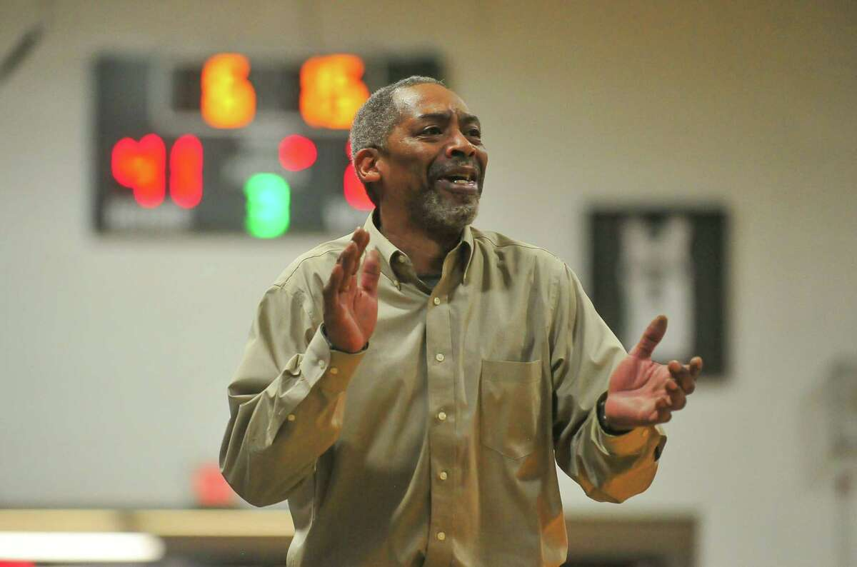 Head Coach Bernie Lofton of the Bassick Lions applauds his teams play during a Division 1 second round game against the East Hartford Hornets at Bassick High School on Friday March 9, 2018 in Bridgeport, Connecticut.