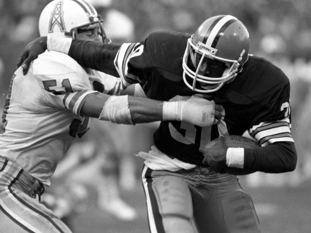 OCTOBER 30, 1983 CLEVELAND, OH: Running back Boyce Green #30 of the Cleveland Browns stiff arms linebacker Ted Thompson #51 of the Houston Oilers during a game on October 30, 1983 at the Cleveland Municipal Stadium in Cleveland, Ohio. Cleveland won 25-19 in overtime. (Photo by: Ron Kuntz Collection/Diamond Images/Getty Images)